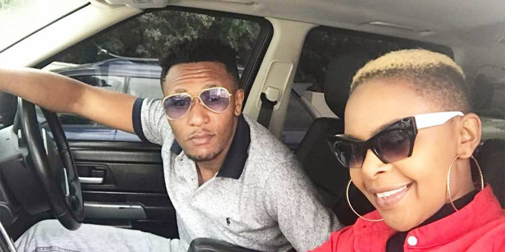 Linet and her hubby in one of their cars