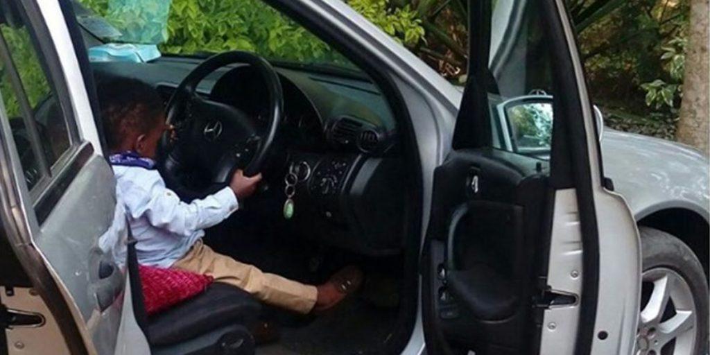 Zahari in his mother's Allion car SRC: @Mpasho News