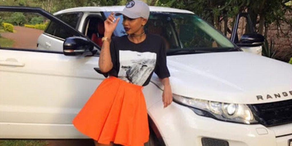 Huddah standing outside her White Range Rover Evogue car SRC: @Ghafla